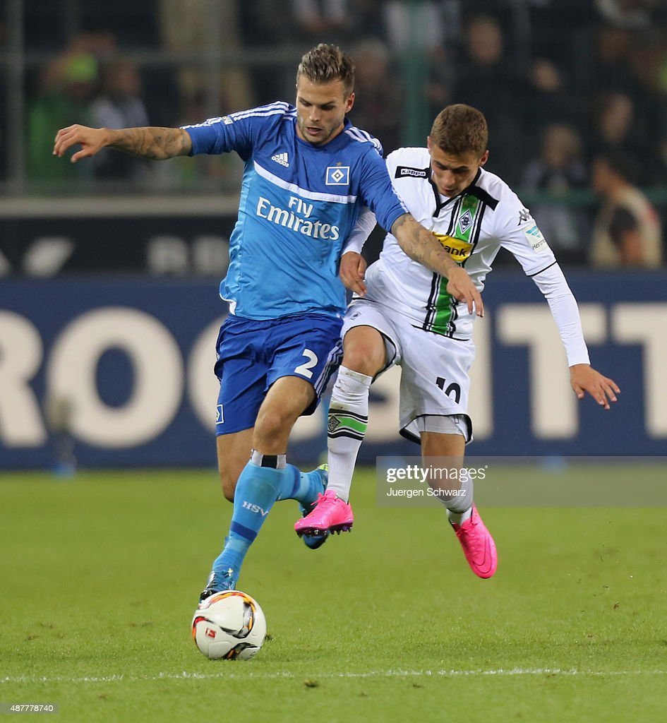 Dennis Diekmeier of Hamburg (L) and Thorgan Hazard of Moenchengladbach fight for the ball during the Bundesliga match between Borussia Moenchengladbach and Hamburger SV at Borussia-Park on September 11, 2015 in Moenchengladbach, Germany.