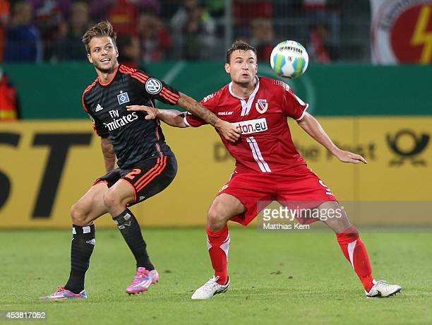 Dennis Diekmeier of Hamburg battles for the ball with Fabian Pawela of Cottbus during the DFB Cup match between FC Energie Cottbus and Hamburger SV...