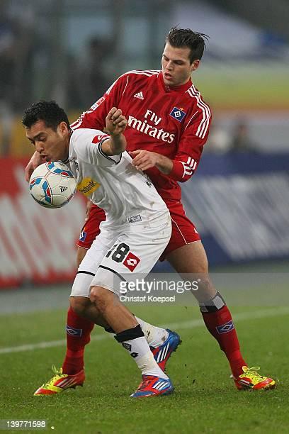 Dennis Diekmeier of Hamburg challenges Juan Arrango of Moenchengladbach during the Bundesliga match between Borussia Moenchengladbach and Hamburger...