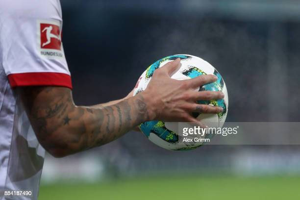 Dennis Diekmeier of Hamburg holds the official adidas matchball Torfabrik before he throws in the ball during the Bundesliga match between SportClub...