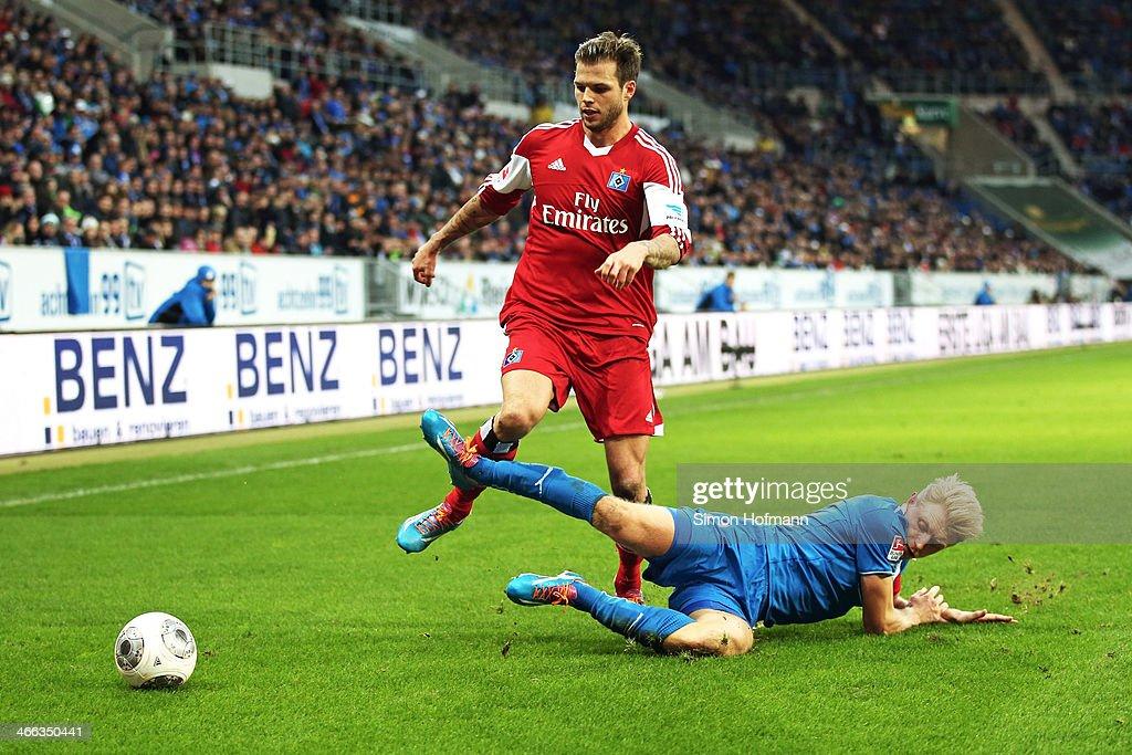 Dennis Diekmeier of Hamburg is challenged by Andreas Beck of Hoffenheim during the Bundesliga match between 1899 Hoffenheim and Hamburger SV at Wirsol Rhein-Neckar Arena Sinsheim on February 1, 2014 in Sinsheim, Germany.