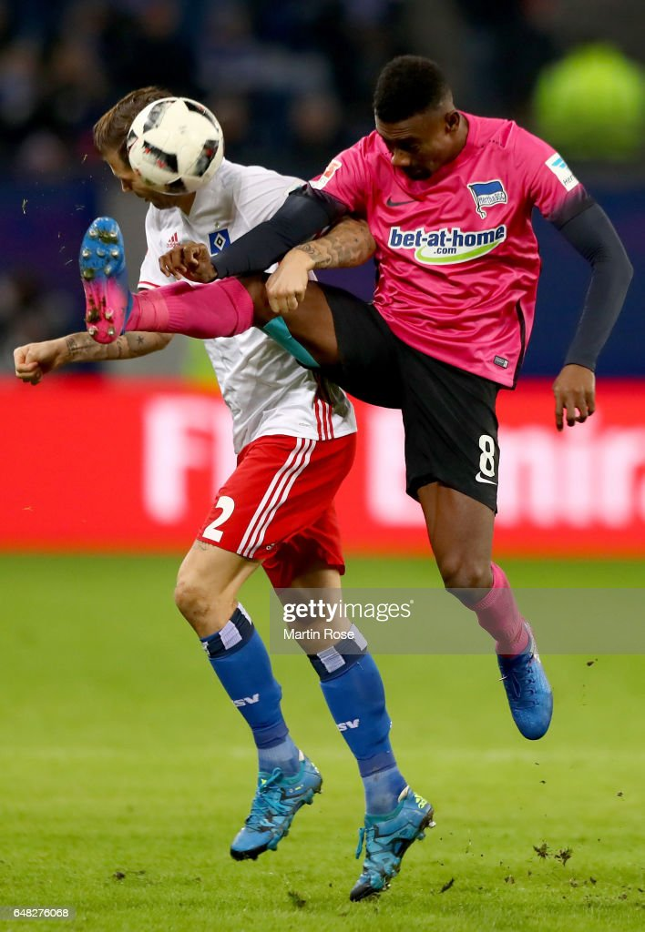 Dennis Diekmeier of Hamburg is challenged by Salomon Kalou of Berlin during the Bundesliga match between Hamburger SV and Hertha BSC at Volksparkstadion on March 5, 2017 in Hamburg, Germany.