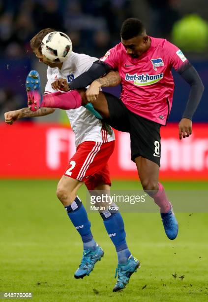 Dennis Diekmeier of Hamburg is challenged by Salomon Kalou of Berlin during the Bundesliga match between Hamburger SV and Hertha BSC at...