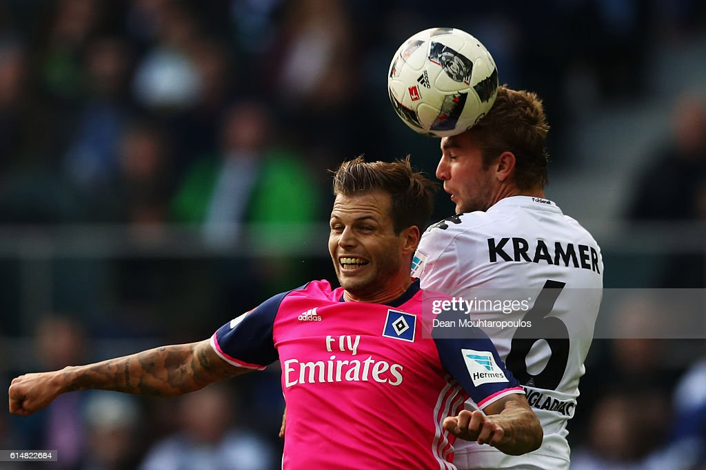 Dennis Diekmeier of Hamburger SV battles for the ball with Christoph Kramer of Borussia Moenchengladbach during the Bundesliga match between Borussia Moenchengladbach and Hamburger SV at Borussia-Park on October 15, 2016 in Moenchengladbach, Germany.
