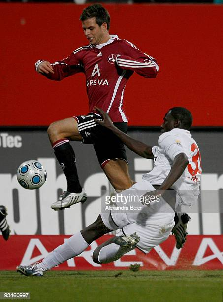Dennis Diekmeier of Nuernberg fights for the ball with Jackson Mendy of Freiburg during the Bundesliga match between 1. FC Nuernberg and SC Freiburg...