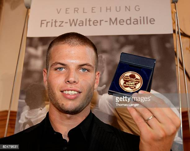 Dennis Diekmeier of Werder Bremen poses with the golden Medal for the best U19 player 2007/2008 during the Fritz Walter Medal Award 2008 at the...