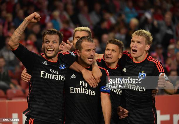 Dennis Diekmeier Rafael van der Vaart Ivo Ilicevic and Artjoms Rudnevs of Hamburger SV celebrates their team's win during the DFP Cup first round...