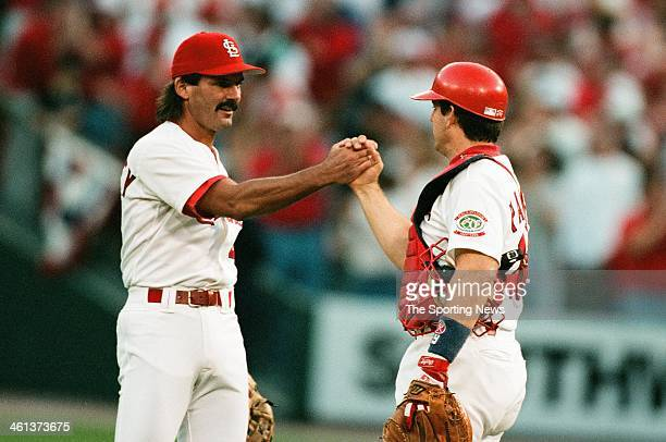 Dennis Eckersley and Tom Pagnozzi of the St Louis Cardinals shake hands during Game Three of the National League Division Series against the Atlanta...