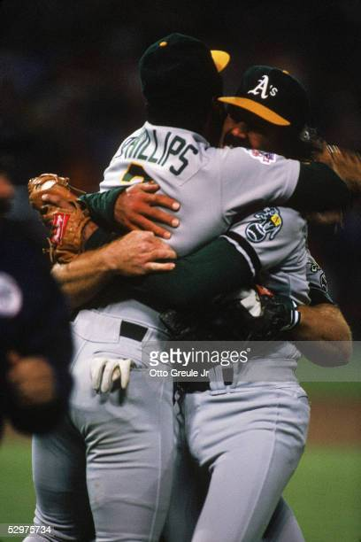 Dennis Eckersley and Tony Phillips of the Oakland Athletics celebrate the final out of game four of the 1989 World Series against the San Francisco...