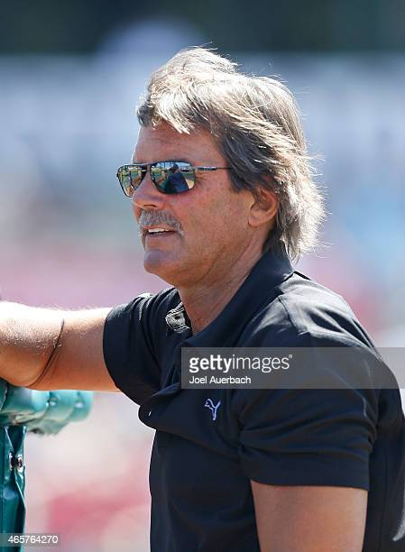 Dennis Eckersley member of the Baseball Hall of Fame watches the Boston Red Sox warm up prior to their spring training game against the St Louis...