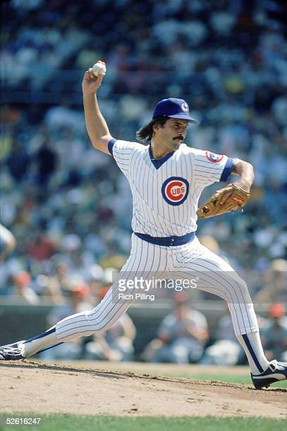 Dennis Eckersley of the Chicago Cubs pitches during a 1985 season game at Wrigley Field in Chicago Illinois Dennis Eckersley played for the Chicago...