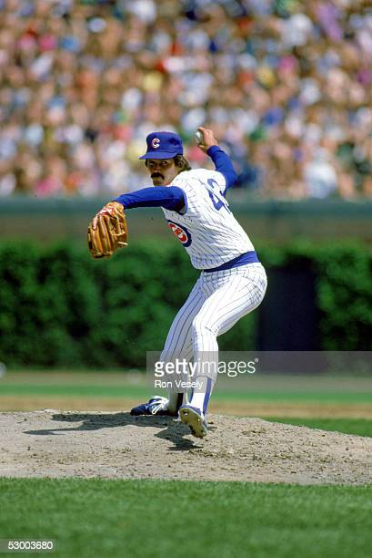 Dennis Eckersley of the Chicago Cubs winds up for the pitch during a season game Dennis Eckersley played for the Chicago Cubs from 19841986