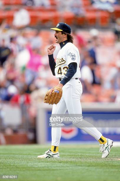 Dennis Eckersley of the Oakland Athletics celebrates after the game at Network Associates Coliseum in Oaklnad California Dennis Eckersley played for...