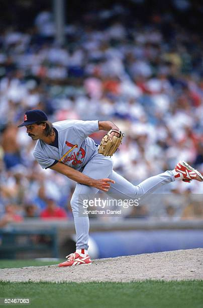 Dennis Eckersley of the St Louis Cardinals delivers a pitch during a game with the Chicago Cubs at Wrigley Field on July 12 1996 in Chicago Illinois...