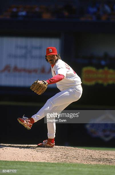 Dennis Eckersley of the St Louis Cardinals winds up for a pitch during a game against the Houston Astros at Busch Stadium on April 14 1997 in St...
