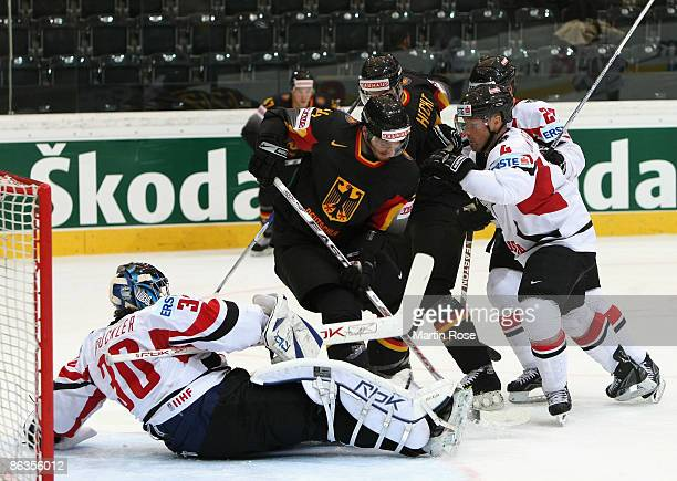 Dennis Endra of Germany tries to score over Bernd Brueckler , goalkeeper of Austria during the IIHF World Ice Hockey Championship relegation round...