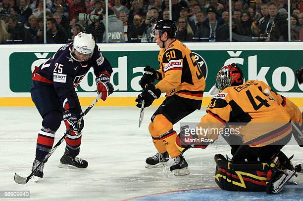Dennis Endras , goalkeepr of Germany saves the shot of David Moss of USA during the IIHF World Championship group D match between USA and Germany at...