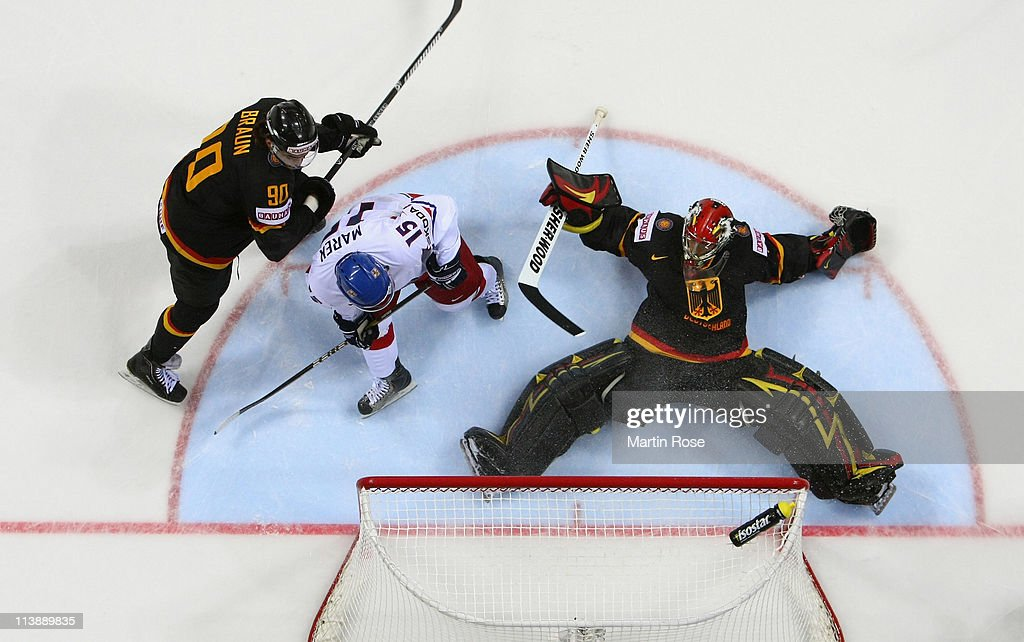 Dennis Endras (R),goaltender of Germany makes a save on Jan Marek (#15) of Czech Republic during the IIHF World Championship qualification match between Germany and Czech Republic at Orange Arena on May 9, 2011 in Bratislava, Slovakia.