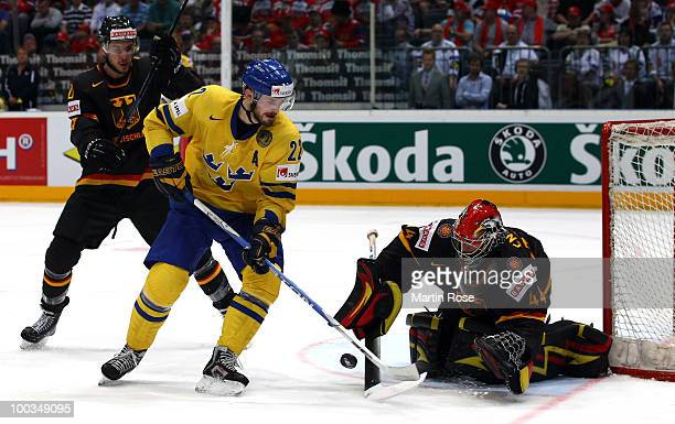 Dennis Endras, goaltender of Germany saves the shot of Niklas Persson of Sweden during the IIHF World Championship bronze medal match between Sweden...