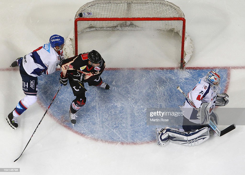 Dennis Endras, goaltender of Mannheim makes a save during the DEL match between Hannover Scorpions and Adler Mannheim at TUI Arena on October 14, 2012 in Hanover, Germany.