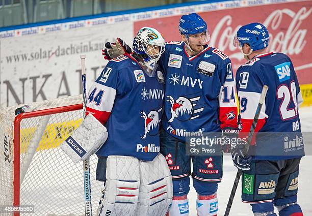 Dennis Endras, Steve Wagner and Dennis Reul of the Adler Mannheim celebrate ihren home victory during the game between Adler Mannheim and Thomas Sabo...