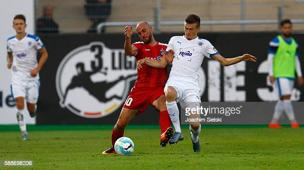 Dennis Engel of Lotte challenges Daniel Brueckner of Erfurt during the third league match between SF Lotte and RotWeiss Erfurt at Frimo Stadion on...