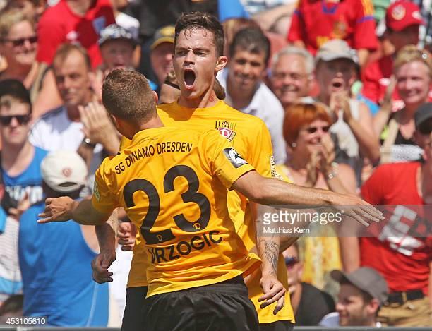 Dennis Erdmann of Dresden jubilates with team mate David Vrzogic after scoring the first goal during the third league match between FC Energie...