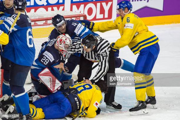 Dennis Everberg fights with Goalie Harri Sateri and Mikko Lehtonen during the Ice Hockey World Championship Semifinal between Sweden and Finland at...