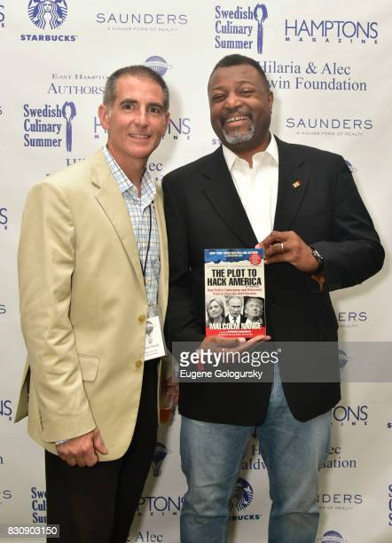 Dennis Fabiszak and Malcolm Nance attend Authors Night 2017 At The East Hampton Library at The East Hampton Library on August 12 2017 in East Hampton...