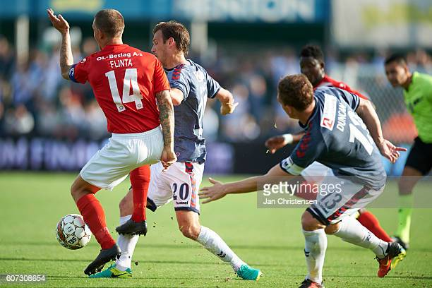 Dennis Flinta of Silkeborg IF and Elmar Bjarnason of AGF Arhus compete for the ball during the Danish Alka Superliga match between Silkeborg IF and...