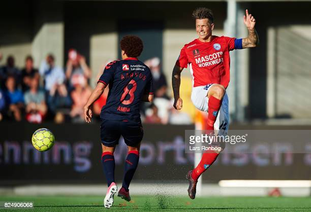 Dennis Flinta of Silkeborg IF and Mustafa Amini of AGF Aarhus compete for the ball during the Danish Alka Superliga match between Silkeborg IF and...
