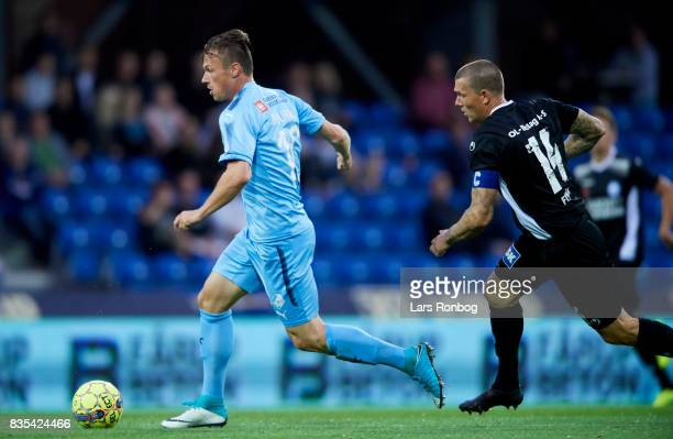 Dennis Flinta of Silkeborg IF chasing Marvin Pourie of Randers FC during the Danish Alka Superliga match between Randers FC and Silkeborg IF at...