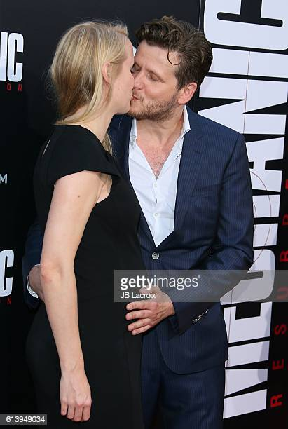 Dennis Gansel and AnnKristin Reese attend the premiere of Summit Entertainment's 'Mechanic Resurrection' on August 22 2016 in Hollywood California