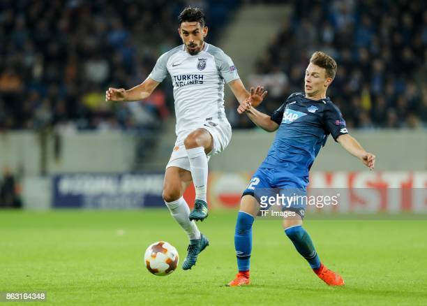 Dennis Geiger of Hoffenheim and Irfan Kahveci of Istanbul Basaksehir battle for the ball during the UEFA Europa League Group C match between 1899...