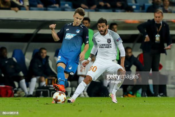 Dennis Geiger of Hoffenheim and Junior Caicara of Istanbul Basaksehir battle for the ball during the UEFA Europa League Group C match between 1899...