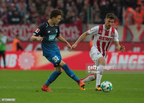 Dennis Geiger of Hoffenheim and Salih Oezcan of FC Koeln battle for the ball during the Bundesliga match between 1 FC Koeln und TSG 1899 Hoffenheim...