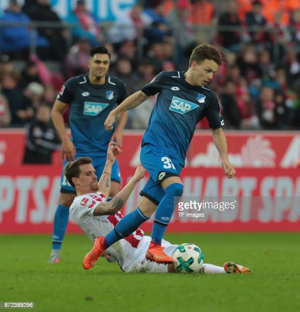 Dennis Geiger of Hoffenheim and Simon Zoller of FC Koeln battle for the ball during the Bundesliga match between 1 FC Koeln und TSG 1899 Hoffenheim...