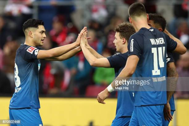Dennis Geiger of Hoffenheim celebrates his team's first goal with team mates Nadiem Amiri and Sandro Wagner during the Bundesliga match between 1 FC...
