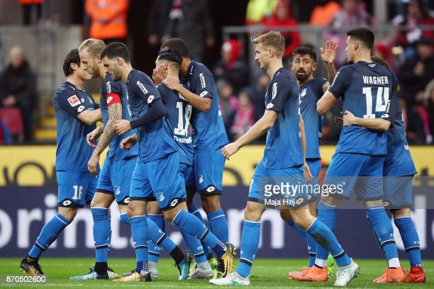 Dennis Geiger of Hoffenheim celebrates his team's first goal with team mates during the Bundesliga match between 1 FC Koeln and TSG 1899 Hoffenheim...