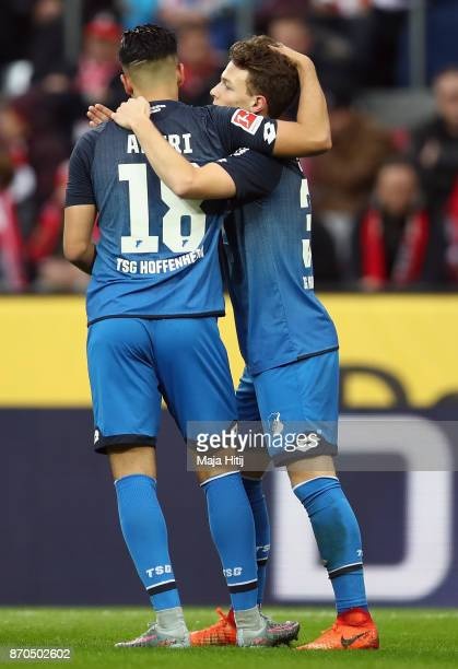 Dennis Geiger of Hoffenheim celebrates his team's first goal with team mate Nadiem Amiri during the Bundesliga match between 1 FC Koeln and TSG 1899...