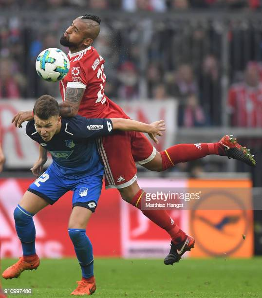 Dennis Geiger of Hoffenheim fights for the ball with Arturo Vidal of Bayern Muenchen during the Bundesliga match between FC Bayern Muenchen and TSG...