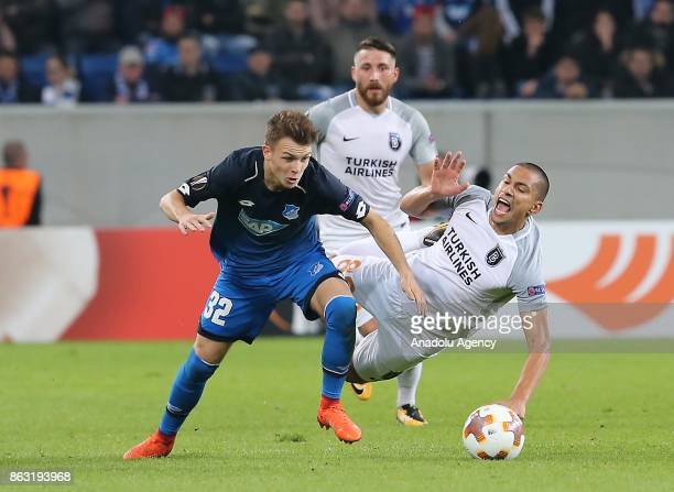 Dennis Geiger of Hoffenheim in action against Gokhan Inler of Medipol Basaksehir during the UEFA Europa League Group C soccer match between...