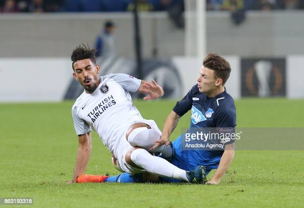 Dennis Geiger of Hoffenheim in action against Irfan Can Kahveci of Medipol Basaksehir during the UEFA Europa League Group C soccer match between...