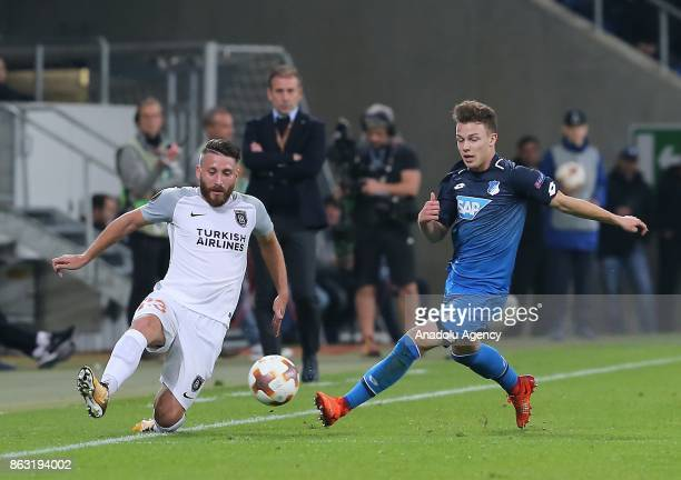 Dennis Geiger of Hoffenheim in action against Tunay Torun of Medipol Basaksehir during the UEFA Europa League Group C soccer match between Hoffenheim...