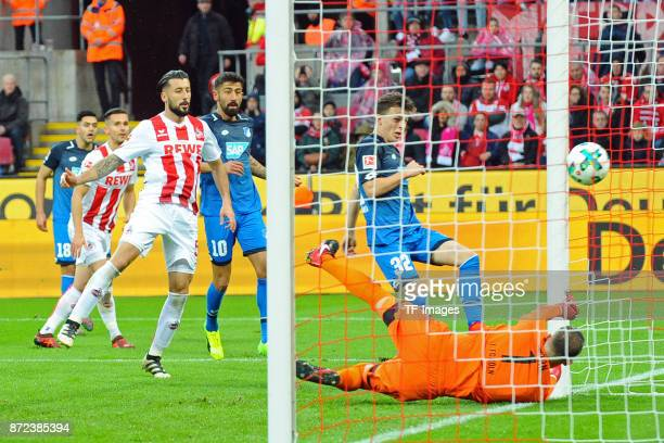 Dennis Geiger of Hoffenheim scores the team`s first goal during the Bundesliga match between 1 FC Koeln and TSG 1899 Hoffenheim at...
