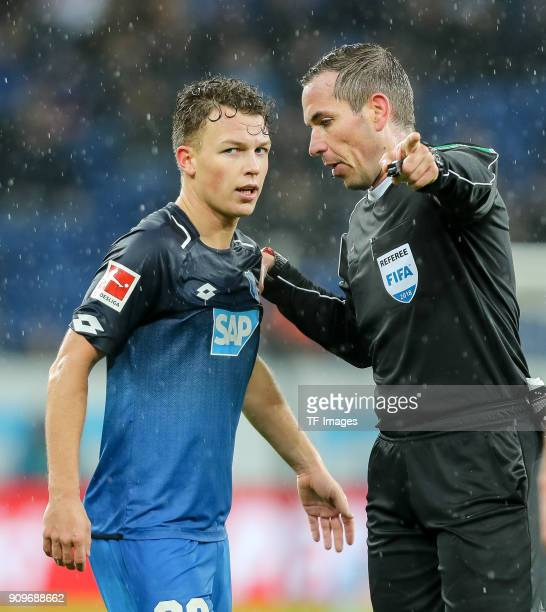 Dennis Geiger of Hoffenheim speaks with Referee Felix Zwayer during the Bundesliga match between TSG 1899 Hoffenheim and Bayer 04 Leverkusen at...