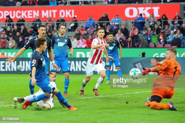 Dennis Geiger of Hoffenheim tries to score a goal but fails at Goalkeeper Timo Horn of FC Koeln during the Bundesliga match between 1 FC Koeln and...