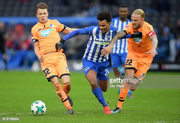 Dennis Geiger of the TSG 1899 Hoffenheim Valentino Lazaro of Hertha BSC and Kevin Vogt of the TSG 1899 Hoffenheim during the Bundesliga match between...