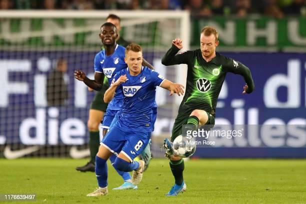 Dennis Geiger of TSG 1899 Hoffenheim battles for possession with Maximilian Arnold of VfL Wolfsburg during the Bundesliga match between VfL Wolfsburg...