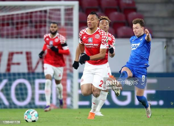 Dennis Geiger of TSG 1899 Hoffenheim fouls Karim Onisiwo of 1. FSV Mainz 05 which leading to a red card being shown during the Bundesliga match...